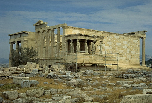 General view of the Erechtheion from the southwest, showing the North Porch (at left), the - The blue limestone foundations of the Old Athena Temple (built c. 510-500 BC and destroyed by the Persians in 480 BC) are visible in the foreground. Photo taken in 1998.