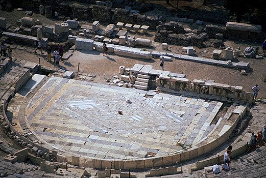 The Theater of Dionysos. - Detail of the orchestra and skene, incuding the Bema of Phaidros. View from the north (from the south wall of the Acropolis). Photo taken in 1998. by Kevin T. Glowacki and Nancy L. Klein