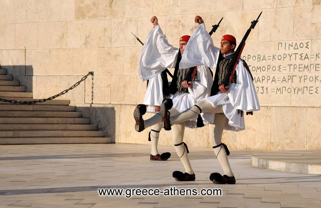 Evzones hange of guard - The Evzones, or Evzoni is the name of several historical elite light infantry and mountain units of the Greek Army. Today, it refers to the members of the Presidential Guard, an elite ceremonial unit that guards the Greek Tomb of the Unknown Soldier, the