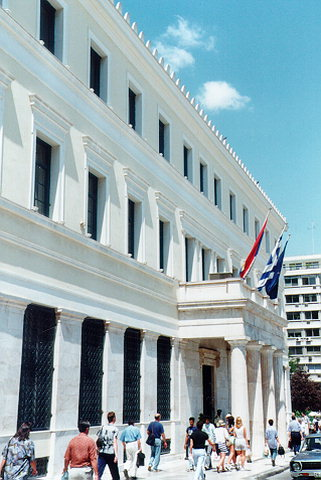 Athens City Hall marble propylon - Three-storied building of austere morphological elements. The marble propylon at the entrance is one of the characteristic elements of the building while the ground floor is also covered with marble and the openings in between are filled with decorating