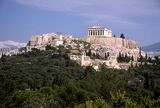 ACROPOLIS HILL - View of the Acropolis from the southwest, showing the Propylaia, the Temple of Athena Nike, part of the Erechtheion, and the Parthenon. Also visible on the South Slope are the Odeion of Herodes Atticus and the Stoa of Eumenes. Photo taken in 1998. by Kevin T. Glowacki and Nancy L. Klein