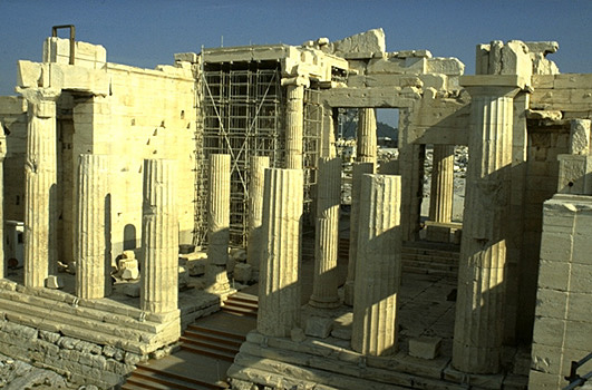 The Propylaia. View of the western facade and central corridor. - There were six Doric columns across the front, with three tall and slender Ionic columns on either side of the central corridor. Photo taken from the Nike Bastion.