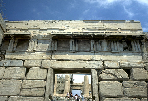 The Beule Gate (The Late Roman entrance to the Acropolis). - Built into the wall above the doorway are remains of the choregic monument of Nikias.