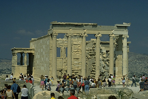 The east and south sides of the Erechtheion (with tourists for scale). - View from the east (and slightly to the south).